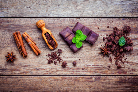 chocolate powder: Ingredients for bakery ,chocolate bar ,chocolate powder ,star anise and cinnamon sticks setup on shabby  wooden background.