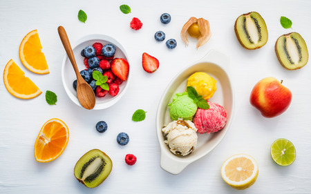 peppermint cream: Colorful ice cream with mixed berry and various fruits raspberry ,blueberry ,strawberry ,orange ,kiwi ,apple,lemon and peppermint setup on white background