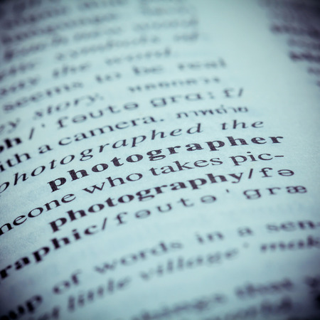 definition define: Close up of old English dictionary page with word Photographer. Shallow depth of field and toned page of word Photographer on English dictionary .