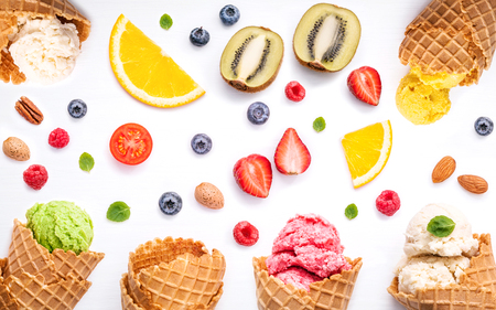 peppermint cream: Colorful ice cream with cones and various fruits raspberry ,blueberry ,strawberry  and peppermint leaves setup on white background flat lay and copy space . Summer and Sweet menu concept.