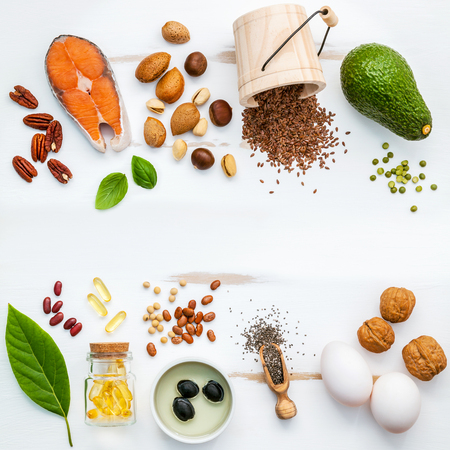 Selection food sources of omega 3 . Super food high omega 3 and unsaturated fats for healthy food. Almond ,pecan ,hazelnuts,walnuts ,olive oils ,fish oils ,salmon ,flax seeds ,chia ,eggs and avocado . Stock fotó - 73608448