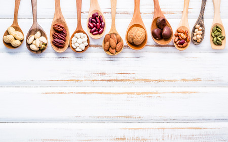Selection food sources of omega 3 and unsaturated fats. Superfood high vitamin e and dietary fiber for healthy food. Mixed nuts almond ,pecan,hazelnuts,walnuts and various beans on white background. Stock Photo