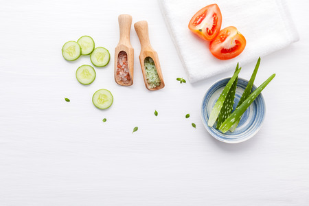 Top view ingredients cucumber ,aloe vara ,himalayan salt ,tomato and thyme