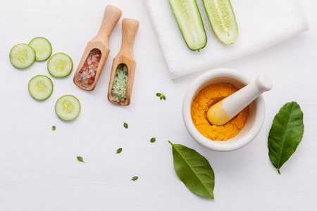 Top view ingredients cucumber tumeric powder and salt on table Stock Photo