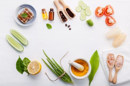 Top view ingredients cucumber ,aloe vera ,lemon ,honey ,himalayan salt and tomato on table Stock Photo