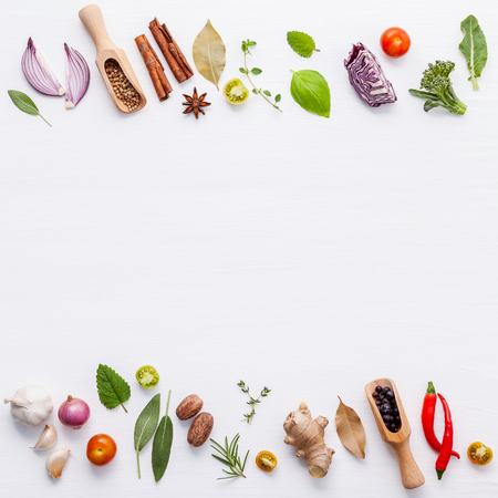 Various fresh vegetables and herbs on white background.Ingredients for cooking concept sweet basil ,tomato ,garlic ,pepper and onion with flat lay. 스톡 콘텐츠