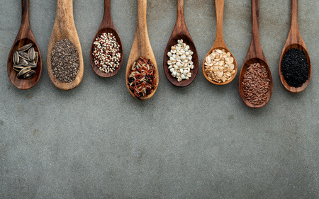 Different types of grains and cereals on shabby concrete