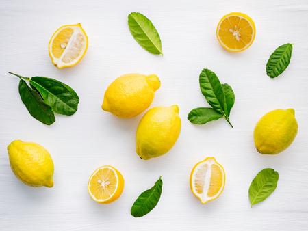 Fresh lemons and  lemons leaves on white wooden Stock Photo