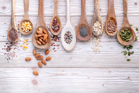 Different types of grains and cereals on shabby wooden Standard-Bild