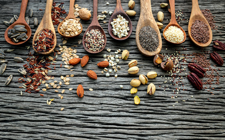 Different types of grains and cereals on shabby wooden Stock Photo