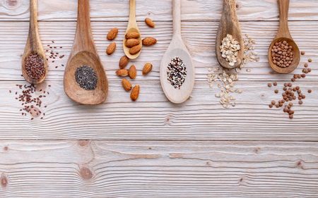 Different types of grains and cereals on shabby wooden Reklamní fotografie