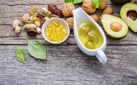 Selection food sources of omega 3 and unsaturated fats. Super foods high vitamin e and dietary fiber for healthy food on wooden