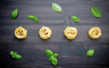 Ingredients for homemade pasta on dark wooden