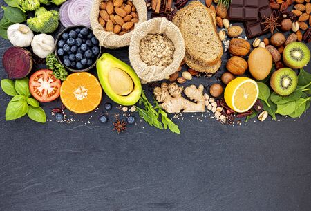 Ingredients for the healthy foods selection. The concept of healthy food set up on dark stone Stock Photo