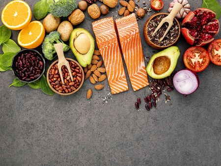 Ingredients for the healthy foods selection on dark background. Balanced healthy ingredients of unsaturated fats and fiber for the heart and blood vessels. Stok Fotoğraf