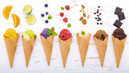 Various of ice cream flavor in cones on white wooden