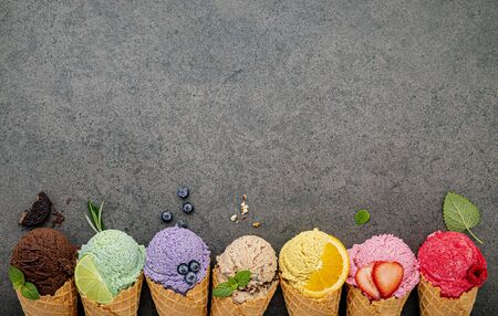 Various of ice cream flavor in cones  on dark stone