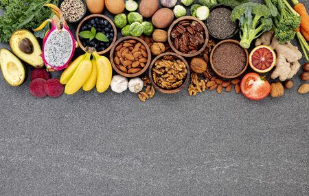 Ingredients for the healthy foods selection. The concept of healthy food set up on dark stone background. Zdjęcie Seryjne