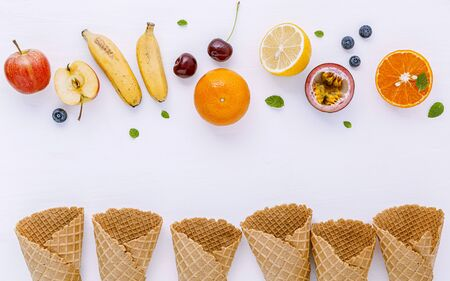 Flat lay various fresh fruits blueberry ,strawberry ,orange ,banana ,passion fruit ,apple and cherry setup on white background . Summer and Sweet menu concept. Zdjęcie Seryjne