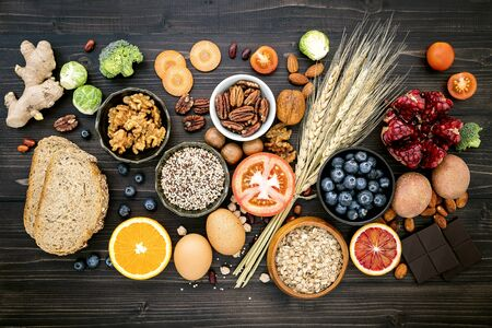 Ingredients for the healthy foods selection on wooden
