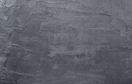 Dark black concrete wall texture background. Natural black slate concrete  background pattern.