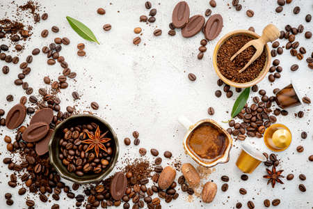 Background of various coffee , dark roasted coffee beans , ground and capsules with scoops setup on white concrete background with copy space. Standard-Bild