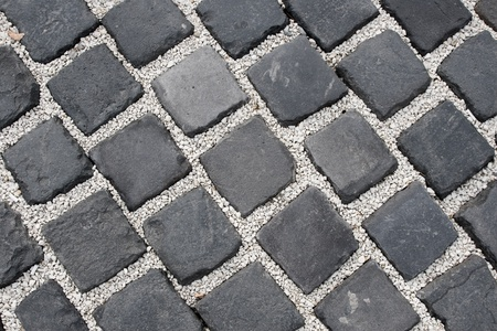 The fragment of a pavement. Paved road.