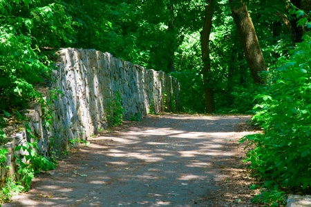 pathway in a peaceful green park Stock Photo
