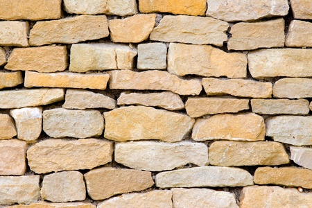 surface of vintage stone wall at old street