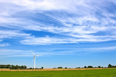 meadow with wind turbines generating electricity photo