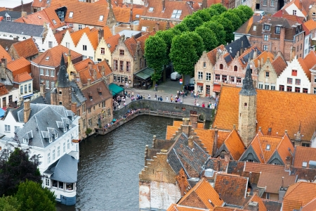 flemish: Roofs of Flemish Houses and canal in Brugge, Belgium