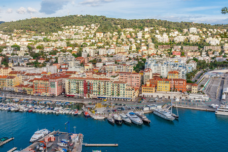 cote d'azur: Panoramic view of coastline and beach with blue sky, luxury resort and bay with yachts, Nice port, Villefranche-sur-Mer, Nice, Cote dAzur, French Riviera.