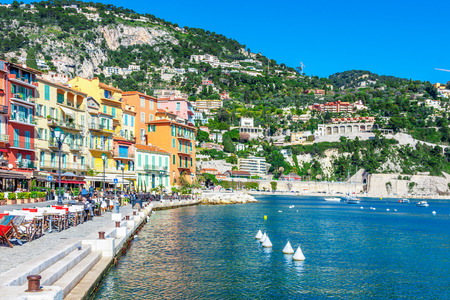 Panoramic view of coastline and beach with blue sky, luxury resort and bay with yachts, Nice port, Villefranche-sur-Mer, Nice, Cote dAzur, French Riviera.