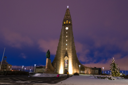 Night view of Skolavordustigur street leading to the Hallgrimskirkja Church, one of the landmarks of Reykjavik, the capital city of Iceland. Editorial