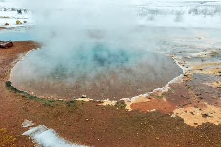 Strokkur geyser in geothermal area Haukadalur in wintertime, Iceland Stock Photo