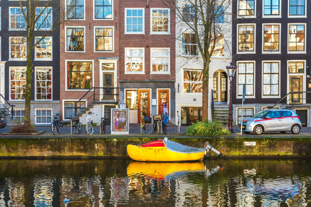 Old buildings in Amsterdam in sunny and bright day Editorial