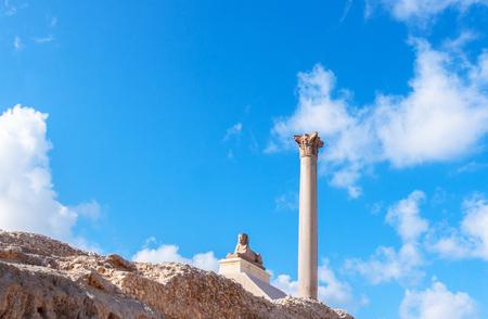 Pompeys pillar and ancient sphinx statue roman triumphal column in Alexandria, Egypt Stock Photo