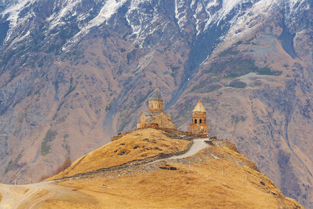 Gergeti Trinity Church (Tsminda Sameba), Holy Trinity Church near the village of Gergeti in Georgia, under Mount Kazbegi Stock Photo