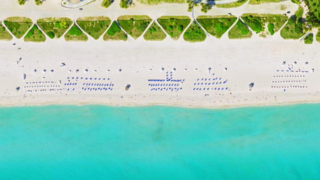 aerial bird's eye view of surfer in tropical clear water miami beach Stock Photo