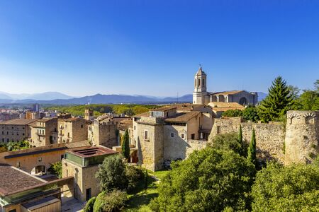 Girona Cathedral, also known as the Cathedral of Saint Mary of Girona, aerial view of Girona city in summer day with blue sky, Girona landmarks, Catalonia, Spain Reklamní fotografie