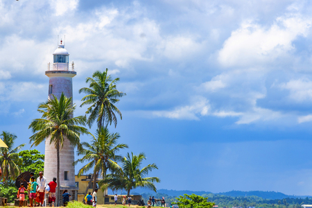 Galle, Sri Lanka - May 1, 2016: Lighthouse in Galle fort historic lighthouse at a fort with simple style and a nearby beach popular with swimmers, Galle, Sri Lanka