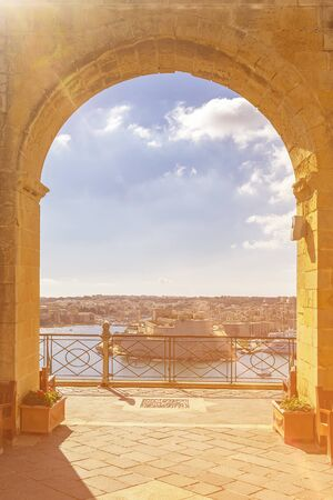Fort St. Angelo in Birgu, view through the arch in the Upper Barrakka Gardens, Valletta, Malta