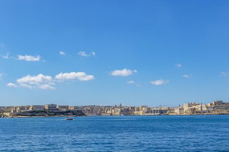 Valletta, Malta - Aerial skyline view of the sea entrance of Valletta, Grand Harbor, Birgu, Senglea and Manoel Island