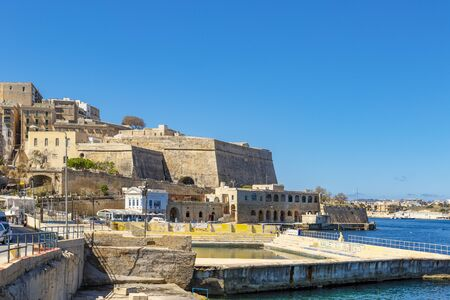 Ancient fortifications of Valletta and outdoor pool, medieval castle city stone walls fortification, grand harbour In Valletta, Malta