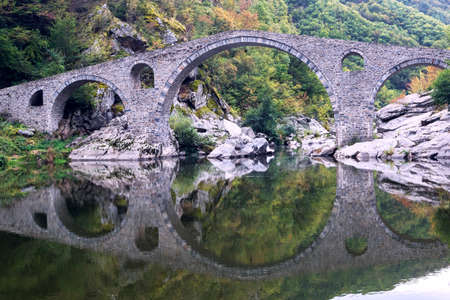 Devil's bridge is three-arched bridge over the Arda River in a narrow gorge  part of an ancient road system, Bulgaria.
