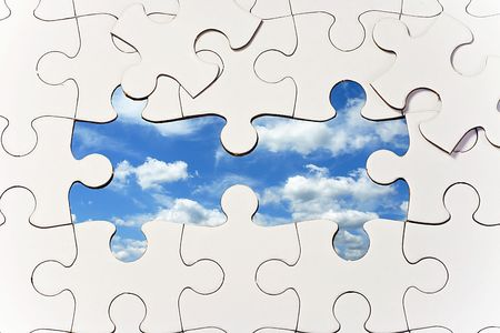 Puzzle with missing pieces revealing blue sky Stock Photo - 8106645
