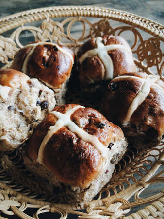 Basket with hot cross buns at Easter Stock Photo