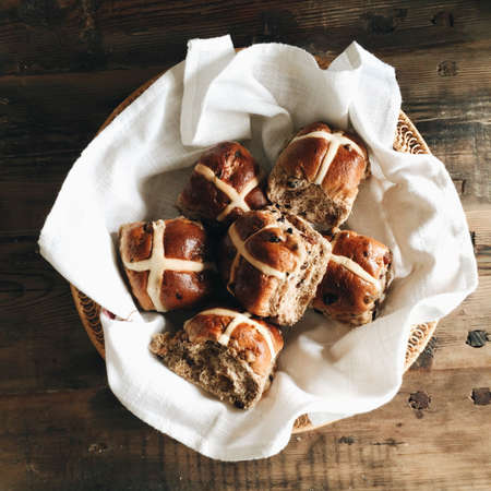 Basket with hot cross buns at Easter