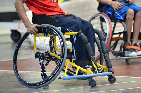 Basketball player in the wheelchair competition for athletes with disabilities games Stock Photo