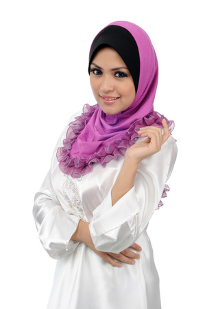 arab model: Beautiful young muslim woman with warm welcome smile isolated on white background
